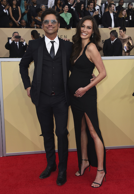 <div class='meta'><div class='origin-logo' data-origin='AP'></div><span class='caption-text' data-credit='Jordan Strauss/Invision/AP'>John Stamos, left, and Caitlin McHugh arrive at the 24th annual Screen Actors Guild Awards at the Shrine Auditorium & Expo Hall on Sunday, Jan. 21, 2018, in Los Angeles.</span></div>