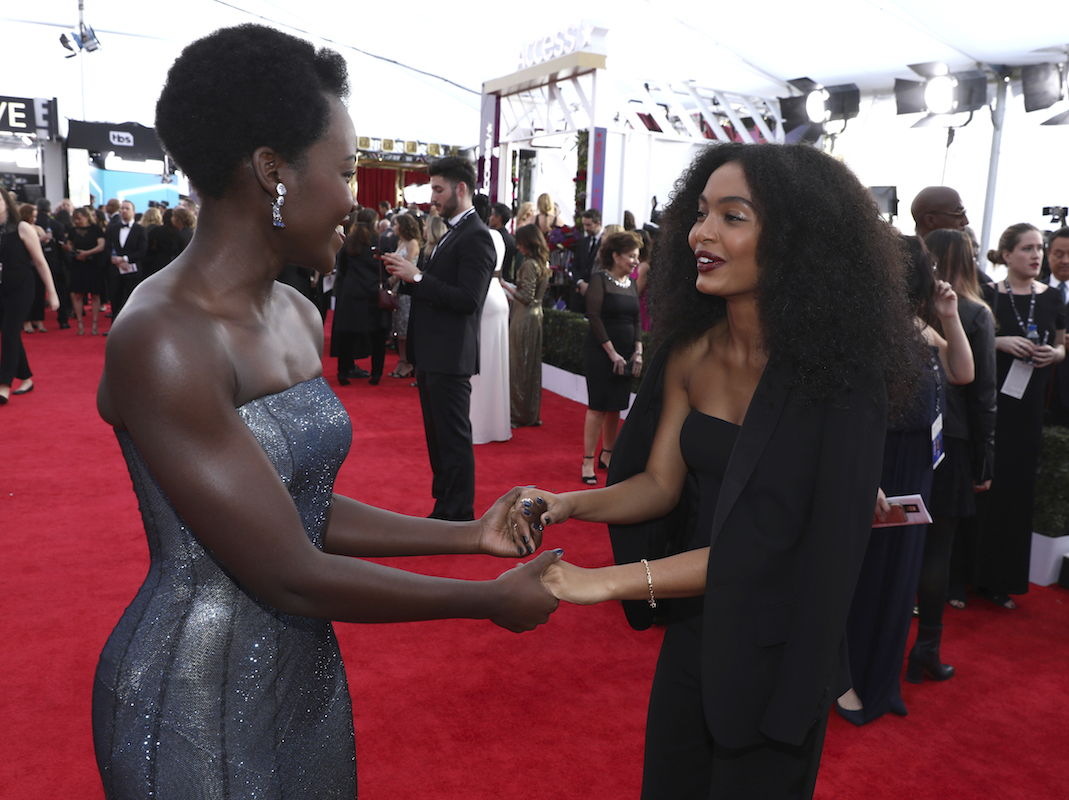 <div class='meta'><div class='origin-logo' data-origin='AP'></div><span class='caption-text' data-credit='Matt Sayles/Invision/AP'>Lupita Nyong'o, left, and Yara Shahidi arrive at the 24th annual Screen Actors Guild Awards at the Shrine Auditorium & Expo Hall on Sunday, Jan. 21, 2018, in Los Angeles.</span></div>