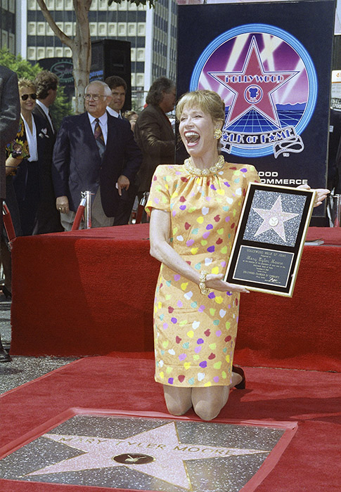 <div class='meta'><div class='origin-logo' data-origin='AP'></div><span class='caption-text' data-credit='AP Photo/Chris Martinez'>Actress Mary Tyler Moore reacts to fans and media after being honored with her star on the Hollywood Walk of Fame, Tuesday, Sept. 8, 1992 in Los Angeles.</span></div>