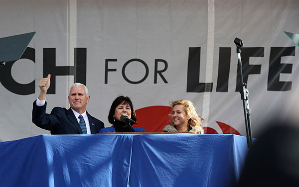 "<div class=""meta image-caption""><div class=""origin-logo origin-image none""><span>none</span></div><span class=""caption-text"">Vice President Mike Pence, with his wife Karen Pence, center, waves while speaking at the March for Life on the National Mall in Washington, Friday, Jan. 27, 2017. (Manuel Balce Ceneta/AP Photo)</span></div>"