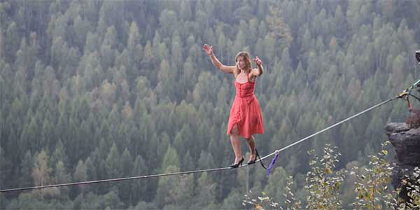 <div class='meta'><div class='origin-logo' data-origin='none'></div><span class='caption-text' data-credit='Faith Dickey/thatslacklinegirl.com'>Record-holding highliner Faith Dickey talks about how she took the extreme sport to the next level by walking in high heels.</span></div>