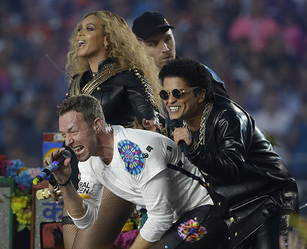 <div class='meta'><div class='origin-logo' data-origin='AP'></div><span class='caption-text' data-credit='AP Photo/Marcio Jose Sanchez'>Coldplay singer Chris Martin performs with Beyoncé and Bruno Mars during halftime of the NFL Super Bowl 50 football game Sunday, Feb. 7, 2016.</span></div>