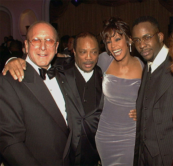 <div class='meta'><div class='origin-logo' data-origin='none'></div><span class='caption-text' data-credit='Photo/AP Photo'>Feb 1996: Arista Records head Clive Davis, left, at his 10th annual pre-Grammy party with, from left, Quincy Jones, Whitney Houston, and Bobby Brown.</span></div>
