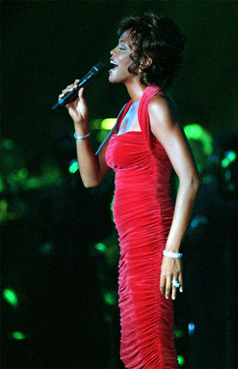 <div class='meta'><div class='origin-logo' data-origin='none'></div><span class='caption-text' data-credit='Photo/AP Photo'>Sept. 1996: Houston performs for the Black Entertainment Televisions's awards gala, receiving BET's second annual Walk of Fame award.</span></div>