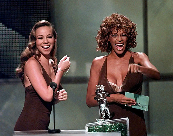 <div class='meta'><div class='origin-logo' data-origin='none'></div><span class='caption-text' data-credit='Photo/AP Photo'>Sept. 1998: Mariah Carey, left, and Whitney Houston present the award for Best Male Video during the MTV Video Music Awards.</span></div>