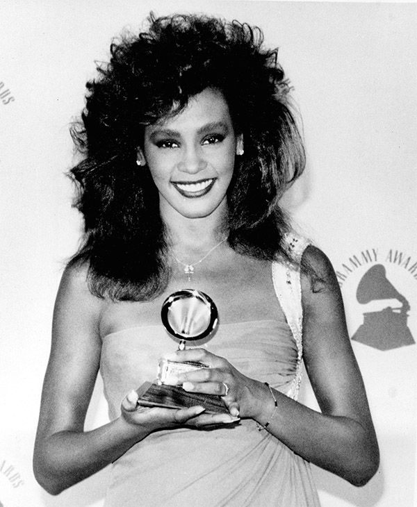 <div class='meta'><div class='origin-logo' data-origin='none'></div><span class='caption-text' data-credit='Photo/AP Photo'>Feb. 1986: Houston poses with her Grammy backstage at the Grammy Awards after winning best female pop vocal performance for her song &#34;Saving All My Love For You.&#34;</span></div>