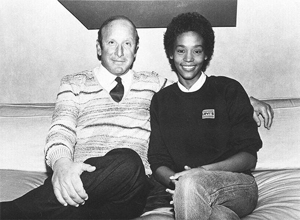 <div class='meta'><div class='origin-logo' data-origin='none'></div><span class='caption-text' data-credit='Photo/AP Photo'>1983: Houston with music producer Clive Davis shortly after signing a contract with Arista Records.</span></div>