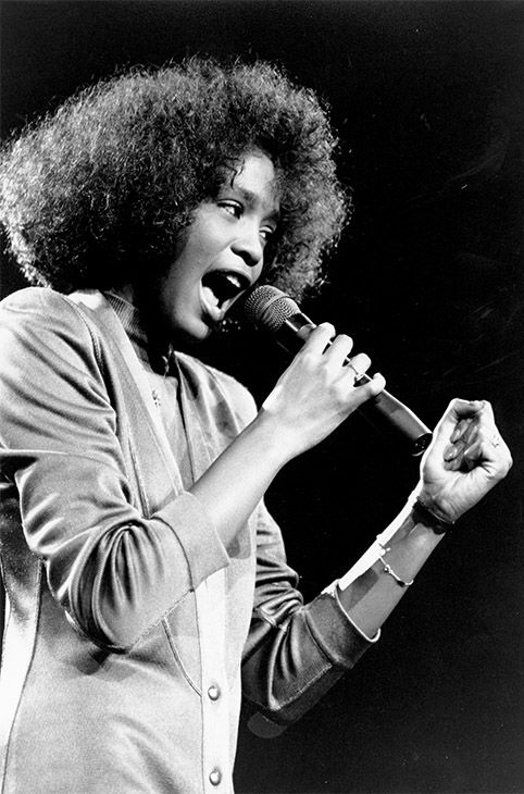<div class='meta'><div class='origin-logo' data-origin='none'></div><span class='caption-text' data-credit='Photo/AP Photo'>May 1986: Houston belts out a song during her segment of a benefit concert at Boston Garden.</span></div>