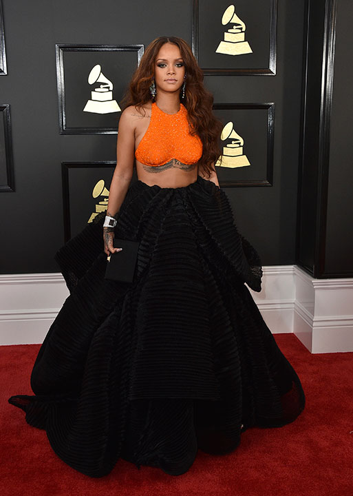 "<div class=""meta image-caption""><div class=""origin-logo origin-image none""><span>none</span></div><span class=""caption-text"">Rihanna arrives at the 59th annual Grammy Awards at the Staples Center on Sunday, Feb. 12, 2017, in Los Angeles. (Jordan Strauss/Invision/AP)</span></div>"