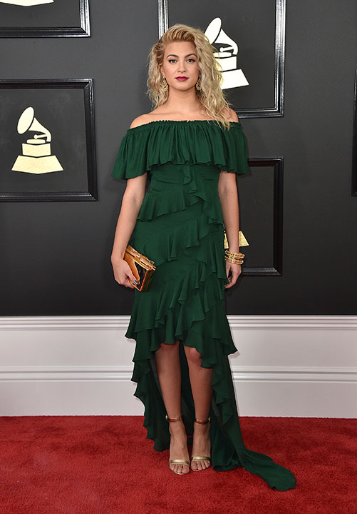 "<div class=""meta image-caption""><div class=""origin-logo origin-image none""><span>none</span></div><span class=""caption-text"">Tori Kelly arrives at the 59th annual Grammy Awards at the Staples Center on Sunday, Feb. 12, 2017, in Los Angeles. (Jordan Strauss/Invision/AP)</span></div>"