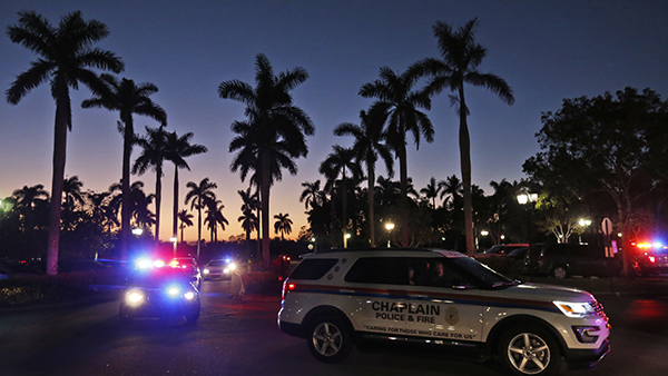 <div class='meta'><div class='origin-logo' data-origin='AP'></div><span class='caption-text' data-credit='AP Photo/Wilfredo Lee'>Law enforcement vehicles arrive at a hotel where parents were instructed to pick up their children in Coral Springs, Fla., Wednesday, Feb. 14, 2018.</span></div>