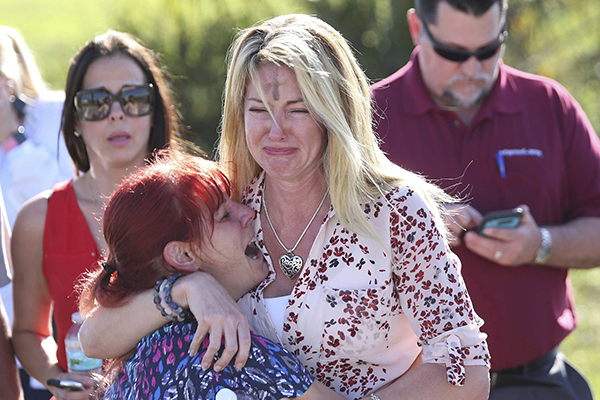 <div class='meta'><div class='origin-logo' data-origin='AP'></div><span class='caption-text' data-credit='AP Photo/Joel Auerbach'>Parents wait for news after a reports of a shooting at Marjory Stoneman Douglas High School in Parkland, Fla., on Wednesday, Feb. 14, 2018.</span></div>