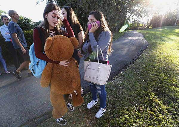 <div class='meta'><div class='origin-logo' data-origin='AP'></div><span class='caption-text' data-credit='AP Photo/Wilfredo Lee'>Students wait to be picked up after a shooting at Marjory Stoneman Douglas High School in Parkland, Fla., Wednesday, Feb. 14, 2018.</span></div>