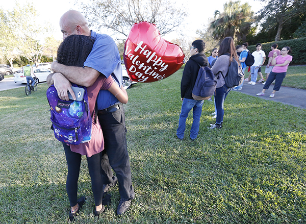 <div class='meta'><div class='origin-logo' data-origin='AP'></div><span class='caption-text' data-credit='AP Photo/Wilfredo Lee'>Family member embrace following a shooting at Marjory Stoneman Douglas High School, Wednesday, Feb. 14, 2018, in Parkland, Fla.</span></div>