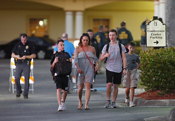<div class='meta'><div class='origin-logo' data-origin='AP'></div><span class='caption-text' data-credit='AP Photo/Wilfredo Lee'>Family members pick up students of Marjory Stoneman Douglas High School in Parkland, Fla., at a nearby hotel, Wednesday, Feb. 14, 2018.</span></div>