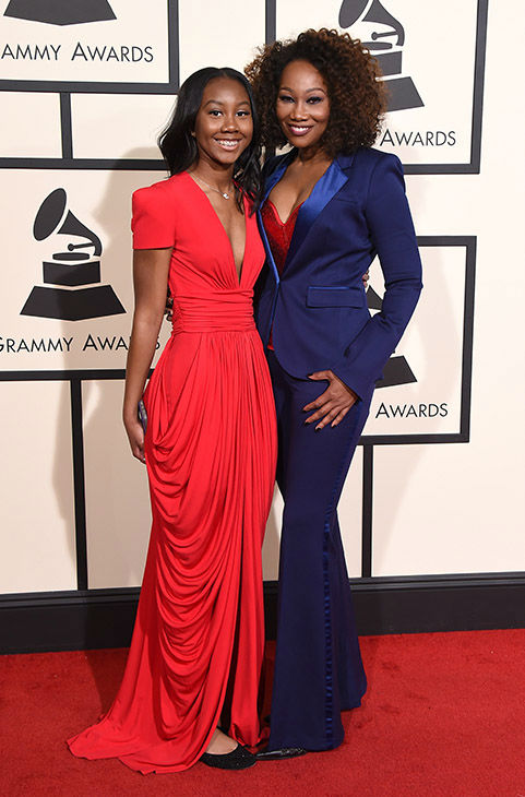 <div class='meta'><div class='origin-logo' data-origin='none'></div><span class='caption-text' data-credit='Jordan Strauss/Invision/AP'>Taylor Crawford, left, and Yolanda Adams arrive at the 58th annual Grammy Awards at the Staples Center on Monday, Feb. 15, 2016, in Los Angeles.</span></div>