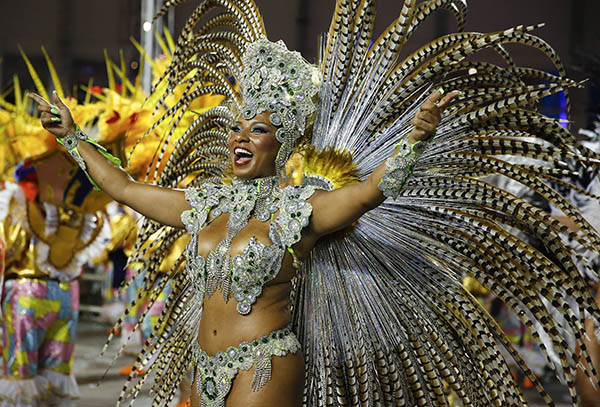 "<div class=""meta image-caption""><div class=""origin-logo origin-image ap""><span>AP</span></div><span class=""caption-text"">A dancer from the Academicos do Tucuruvi samba school performs during the Carnival parade at the Sambodromo in Sao Paulo, Brazil, Friday, Feb. 13, 2015.</span></div>"