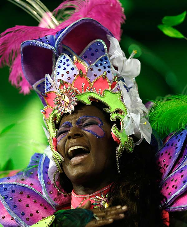 """<div class=""""meta image-caption""""><div class=""""origin-logo origin-image ap""""><span>AP</span></div><span class=""""caption-text"""">A performer from the Portela samba school sings out during Carnival celebrations at the Sambadrome in Rio de Janeiro, Brazil, Monday, Feb. 16, 2015. </span></div>"""