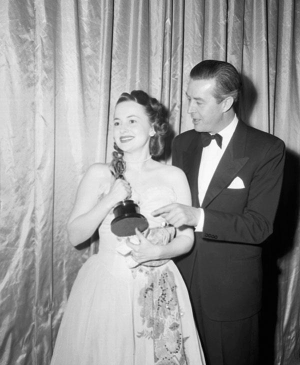 <div class='meta'><div class='origin-logo' data-origin='AP'></div><span class='caption-text' data-credit=''>Actress Olivia De Havilland clasps her &#34;Oscar&#34; on March 13, 1947 in Hollywood, California.</span></div>