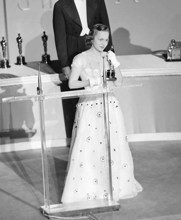 <div class='meta'><div class='origin-logo' data-origin='AP'></div><span class='caption-text' data-credit=''>Olivia De Havilland thanks the Academy members for selecting her as &#34;best actress of the year&#34; during the presentation ceremonies on March 23, 1950 in Hollywood.</span></div>