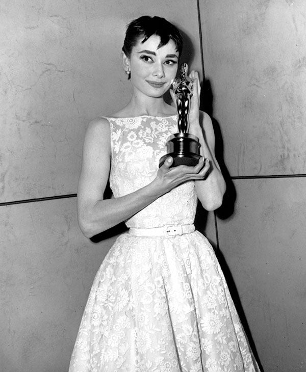 <div class='meta'><div class='origin-logo' data-origin='AP'></div><span class='caption-text' data-credit=''>Oscar-winner Audrey Hepburn poses with her statuette at the 26th Annual Academy Awards ceremony in New York on March 25, 1954.</span></div>