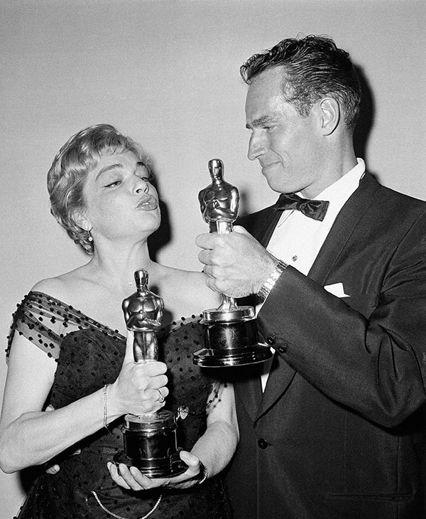 <div class='meta'><div class='origin-logo' data-origin='AP'></div><span class='caption-text' data-credit=''>France's Simone Signoret and Hollywood's Charlton Heston, who each won Academy Award Oscars in Hollywood, Los Angeles on April 4, 1960 compare their statuettes backstage.</span></div>