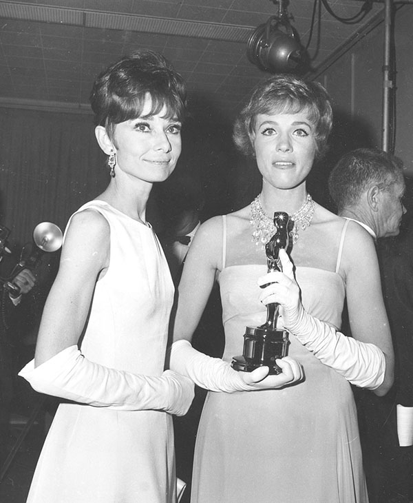 <div class='meta'><div class='origin-logo' data-origin='none'></div><span class='caption-text' data-credit=''>Julie Andrews, holding her Oscar statuette, poses with Audrey Hepburn backstage at the 37th annual Academy Awards ceremony at the Santa Monica Civic Auditorium in Santa Monica, Ca.</span></div>