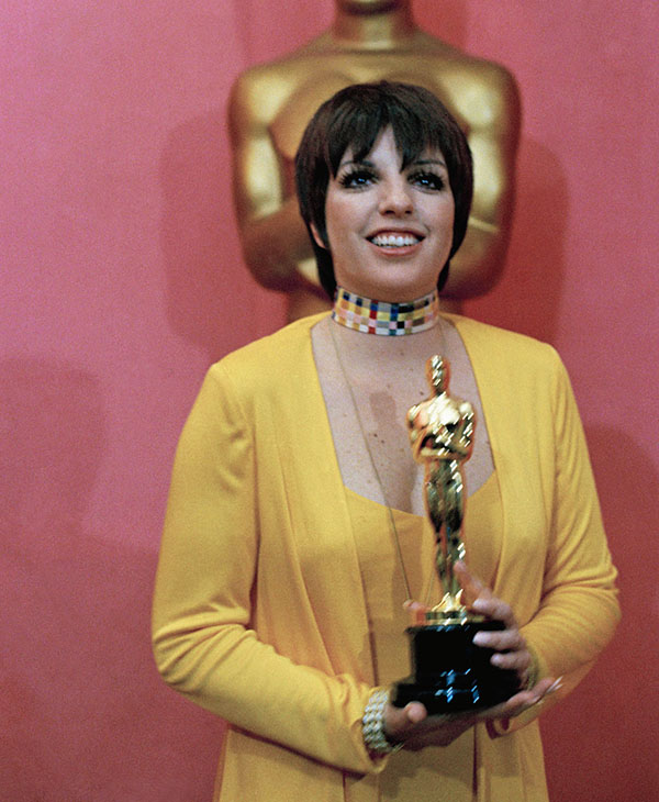 <div class='meta'><div class='origin-logo' data-origin='AP'></div><span class='caption-text' data-credit=''>Liza Minnelli holds her Oscar for &#34;Actress in a Leading Role,&#34; for her work in film, &#34;Cabaret, at the 45th Academy Awards show on March 27, 1973 at Los Angeles, Calif.</span></div>