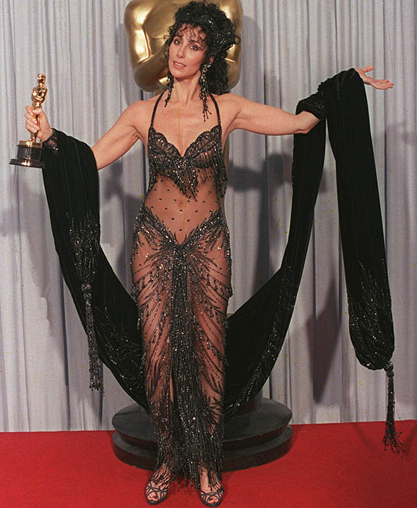 <div class='meta'><div class='origin-logo' data-origin='AP'></div><span class='caption-text' data-credit=''>Cher shows off both her Oscar and Bob Mackie black-sequined gown at the 60th Annual Academy Awards, April 12, 1988 in Los Angeles.</span></div>