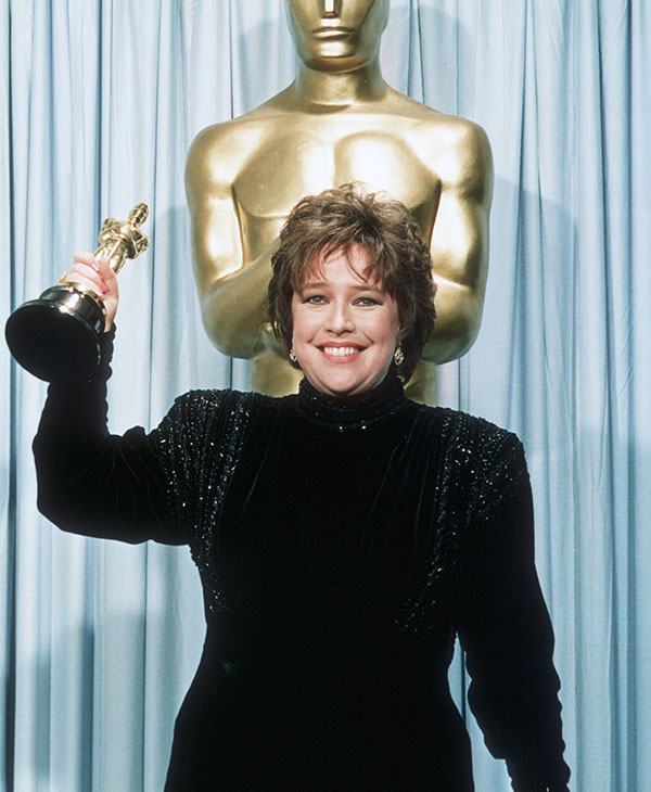 <div class='meta'><div class='origin-logo' data-origin='AP'></div><span class='caption-text' data-credit=''>Kathy Bates holds her Oscar statuette backstage at the 63rd annual Academy Awards in Los Angeles, Ca., March 25, 1991.</span></div>