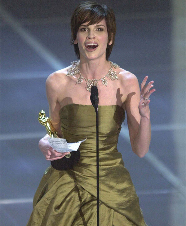 <div class='meta'><div class='origin-logo' data-origin='AP'></div><span class='caption-text' data-credit=''>Hilary Swank talks to her mother who was seated in the balcony of the Shrine Auditorium during the 72nd Academy Awards in Los Angeles, on March 26, 2000.</span></div>