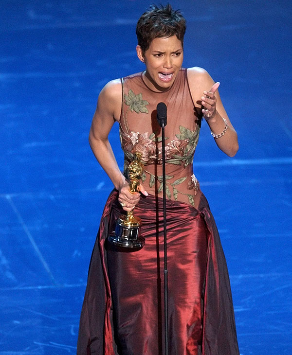 <div class='meta'><div class='origin-logo' data-origin='AP'></div><span class='caption-text' data-credit=''>Halle Berry accepts her Oscar for best actress for her role in Monsters Ball during the 74th annual Academy Awards on Sunday, March 24, 2002, in Los Angeles.</span></div>