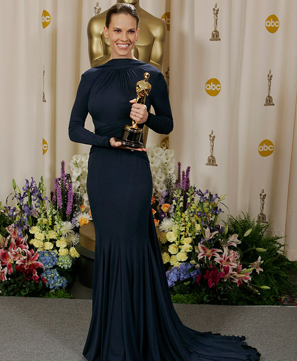 <div class='meta'><div class='origin-logo' data-origin='none'></div><span class='caption-text' data-credit=''>Actress Hilary Swank poses with the Oscar she won for best actress for her work in &#34;Million Dollar Baby&#34; at the 77th Academy Awards Sunday, Feb. 27, 2005, in Los Angeles.</span></div>