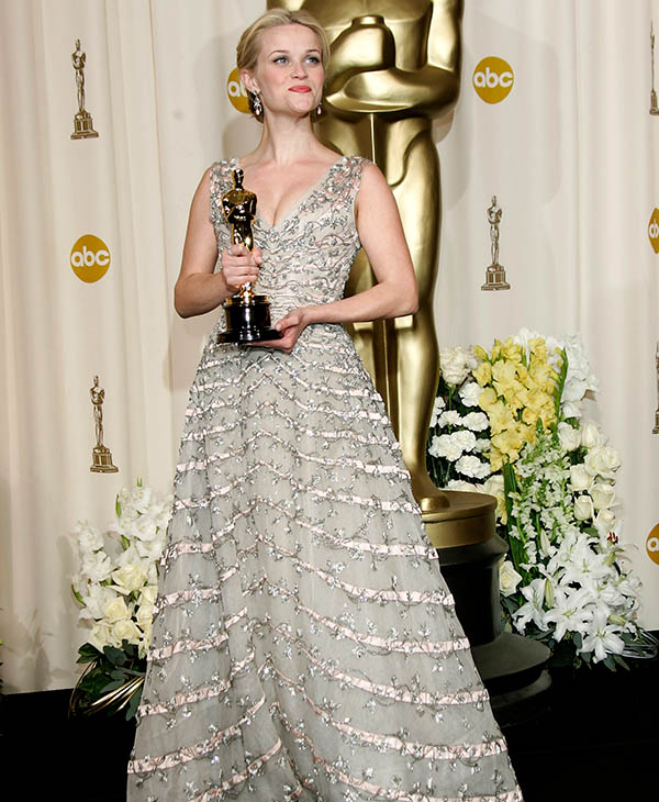 <div class='meta'><div class='origin-logo' data-origin='AP'></div><span class='caption-text' data-credit=''>Actress Reese Witherspoon poses with the Oscar she won for best actress for her work in &#34;Walk the Line&#34; at the 78th Academy Awards Sunday, March 5, 2006, in Los Angeles.</span></div>
