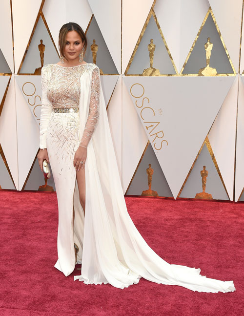 "<div class=""meta image-caption""><div class=""origin-logo origin-image ap""><span>AP</span></div><span class=""caption-text"">Chrissy Teigen arrives at the Oscars on Sunday, Feb. 26, 2017, at the Dolby Theatre in Los Angeles. (Photo by Jordan Strauss/Invision/AP)</span></div>"