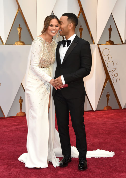 <div class='meta'><div class='origin-logo' data-origin='AP'></div><span class='caption-text' data-credit='Photo by Jordan Strauss/Invision/AP'>Chrissy Teigen, left, and John Legend arrive at the Oscars on Sunday, Feb. 26, 2017, at the Dolby Theatre in Los Angeles.</span></div>