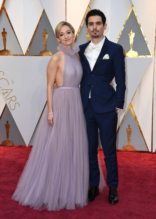 <div class='meta'><div class='origin-logo' data-origin='AP'></div><span class='caption-text' data-credit='Photo by Jordan Strauss/Invision/AP'>Olivia Hamilton, left, and Damien Chazelle arrive at the Oscars on Sunday, Feb. 26, 2017, at the Dolby Theatre in Los Angeles.</span></div>