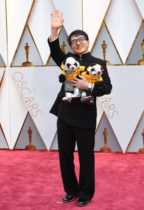 <div class='meta'><div class='origin-logo' data-origin='AP'></div><span class='caption-text' data-credit='Photo by Jordan Strauss/Invision/AP'>Jackie Chan arrives at the Oscars on Sunday, Feb. 26, 2017, at the Dolby Theatre in Los Angeles.</span></div>