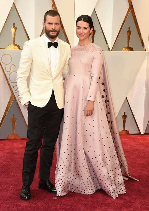 <div class='meta'><div class='origin-logo' data-origin='AP'></div><span class='caption-text' data-credit='Photo by Jordan Strauss/Invision/AP'>Jamie Dornan, left, and Amelia Warner arrive at the Oscars on Sunday, Feb. 26, 2017, at the Dolby Theatre in Los Angeles.</span></div>