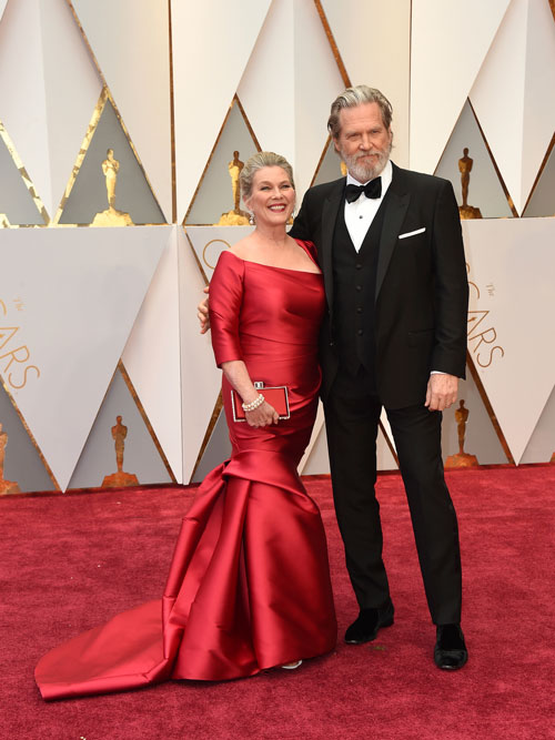 <div class='meta'><div class='origin-logo' data-origin='AP'></div><span class='caption-text' data-credit='Photo by Jordan Strauss/Invision/AP'>Susan Geston, left, and Jeff Bridges arrive at the Oscars on Sunday, Feb. 26, 2017, at the Dolby Theatre in Los Angeles.</span></div>