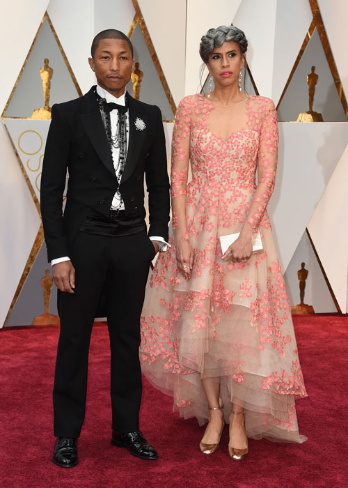 <div class='meta'><div class='origin-logo' data-origin='AP'></div><span class='caption-text' data-credit='Photo by Jordan Strauss/Invision/AP'>Pharrell Williams, left, and Mimi Valdes arrive at the Oscars on Sunday, Feb. 26, 2017, at the Dolby Theatre in Los Angeles.</span></div>