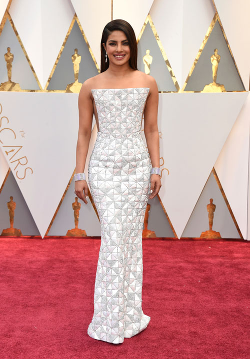 <div class='meta'><div class='origin-logo' data-origin='AP'></div><span class='caption-text' data-credit='Photo by Jordan Strauss/Invision/AP'>Priyanka Chopra arrives at the Oscars on Sunday, Feb. 26, 2017, at the Dolby Theatre in Los Angeles.</span></div>