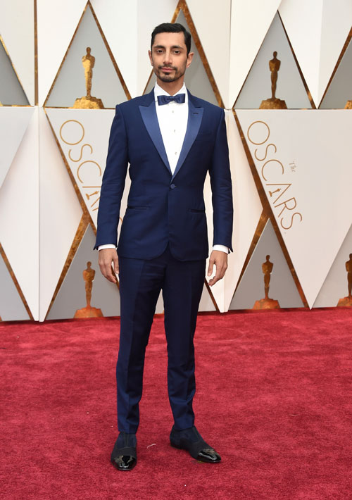 <div class='meta'><div class='origin-logo' data-origin='AP'></div><span class='caption-text' data-credit='Photo by Jordan Strauss/Invision/AP'>Riz Ahmed arrives at the Oscars on Sunday, Feb. 26, 2017, at the Dolby Theatre in Los Angeles.</span></div>
