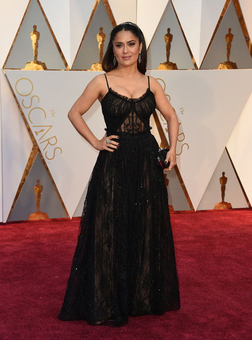 "<div class=""meta image-caption""><div class=""origin-logo origin-image ap""><span>AP</span></div><span class=""caption-text"">Salma Hayek arrives at the Oscars on Sunday, Feb. 26, 2017, at the Dolby Theatre in Los Angeles. (Photo by Jordan Strauss/Invision/AP)</span></div>"