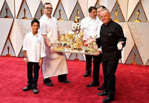 "<div class=""meta image-caption""><div class=""origin-logo origin-image none""><span>none</span></div><span class=""caption-text"">Chef Wolfgang Puck presents Oscars cuisine before the 89th Annual Academy Awards at Hollywood & Highland Center on February 26, 2017 in Hollywood, California. (Photo by Jeff Kravitz/FilmMagic)</span></div>"
