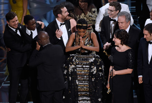 <div class='meta'><div class='origin-logo' data-origin='AP'></div><span class='caption-text' data-credit='Photo by Chris Pizzello/Invision/AP'>Janelle Monae, center, reacts as &#34;Moonlight&#34; is announced as the winner of best picture at the Oscars on Sunday, Feb. 26, 2017, at the Dolby Theatre in Los Angeles.</span></div>