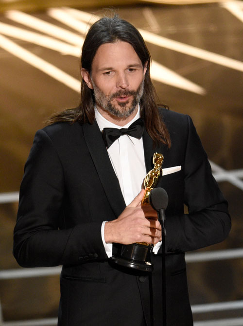 <div class='meta'><div class='origin-logo' data-origin='none'></div><span class='caption-text' data-credit='Photo by Chris Pizzello/Invision/AP'>Linus Sandgren accepts the award for best cinematography for &#34;La La Land&#34; at the Oscars on Sunday, Feb. 26, 2017, at the Dolby Theatre in Los Angeles.</span></div>