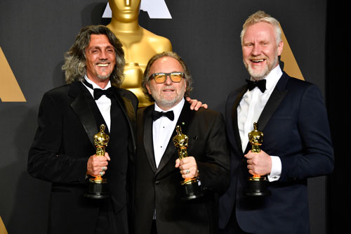 <div class='meta'><div class='origin-logo' data-origin='none'></div><span class='caption-text' data-credit='Photo by Frazer Harrison/Getty Images'>(L-R) Makeup artists Giorgio Gregorini, Alessandro Bertolazzi and Christopher Nelson, winners of the Best Makeup and Hairstyling award for 'Suicide Squad.'</span></div>