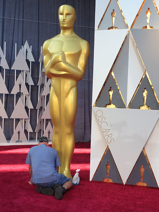 <div class='meta'><div class='origin-logo' data-origin='none'></div><span class='caption-text' data-credit=''>Finishing touches are put on the red carpet and the Dolby Theatre hours before the Oscars ceremony.</span></div>