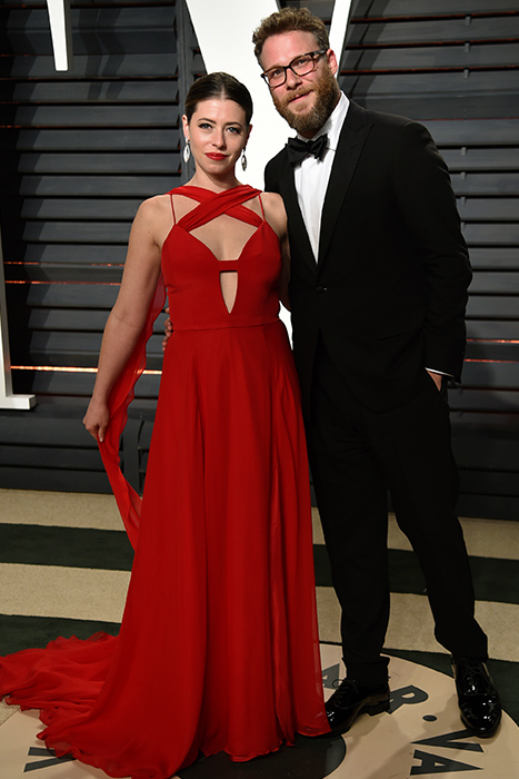 "<div class=""meta image-caption""><div class=""origin-logo origin-image ap""><span>AP</span></div><span class=""caption-text"">Lauren Miller, left, and Seth Rogen arrive at the Vanity Fair Oscar Party on Sunday, Feb. 26, 2017, in Beverly Hills, Calif. (Evan Agostini/Invision/AP)</span></div>"